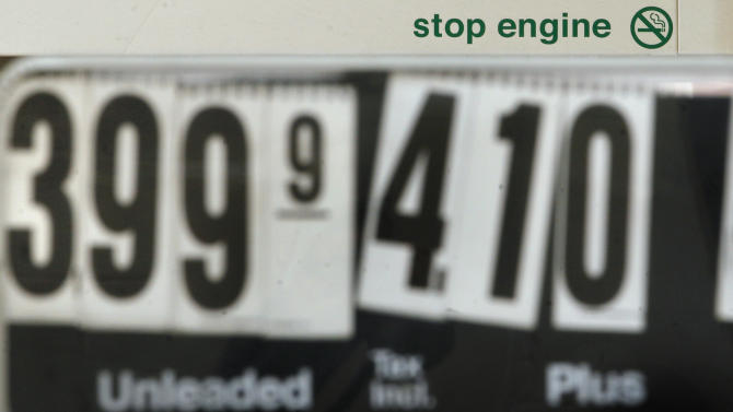 Gas prices at the pump are displayed at a gas station in Stoneham, Mass., Friday, April 22, 2011. With gas prices above $4 in some states, Americans are canceling spring break plans and rethinking summer vacation, and some tourist destinations are offering gas vouchers of as much as $50 to talk people out of giving up and staying home. (AP Photo/Elise Amendola)