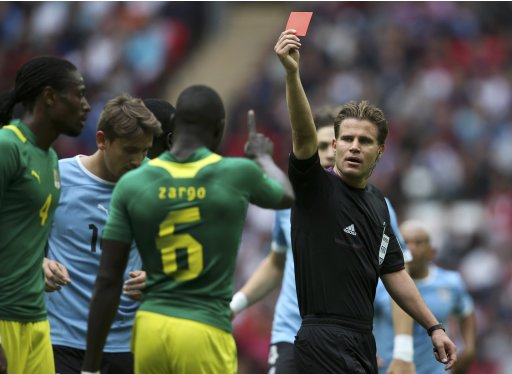 Senegal's Abdoulaye Ba gets a red card during their men's preliminary first round Group A soccer match against Uruguay at the London 2012 Olympic Games in the Wembley Stadium in London