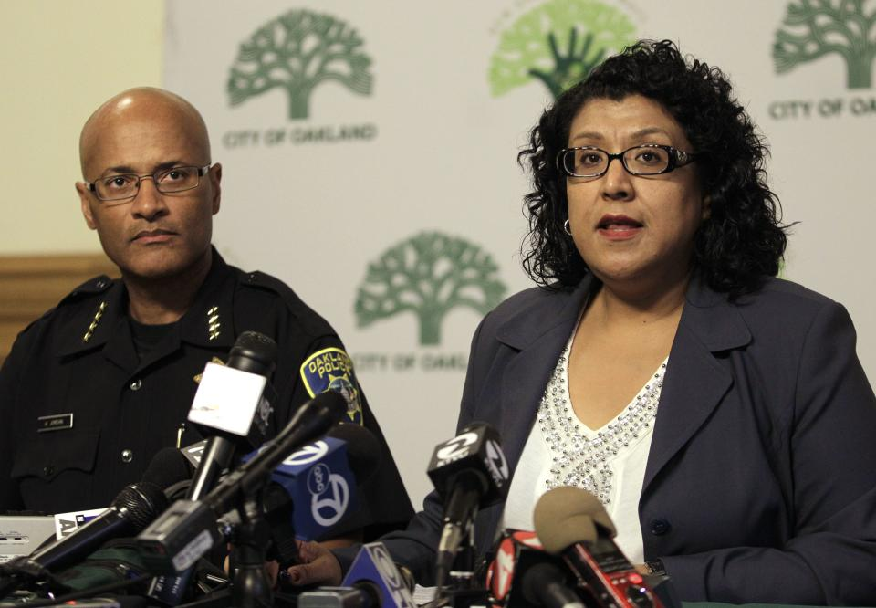 Oakland City Administrator Deanna Santana, right,  speaks beside Interim Chief of Oakland Police Howard Jordan during a media conference Tuesday, Oct. 10, 2011, in Oakland, Calif.  Occupy Oakland protestors were evicted from Frank H. Ogawa plaza early this morning. (AP Photo/Ben Margot)