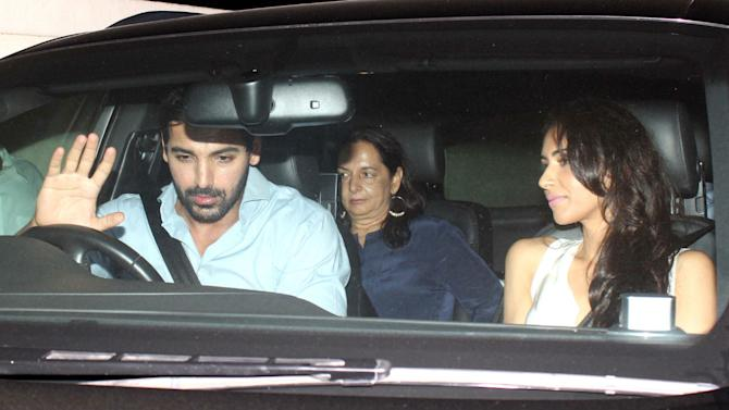 John Abraham heads out with his in-laws