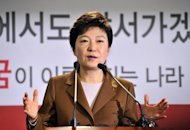 South Korea&#39;s presidential candidate of the ruling New Frontier Party, Park Geun-Hye, speaks at a press conference in Seoul on November 5, 2012. South Korea&#39;s ruling party has threatened to sue an artist who painted its presidential candidate Park giving birth to her father, former dictator Park Chung-Hee