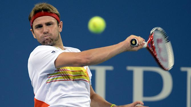 Mardy Fish returns a shot to Gilles Simon of France in the third round of play at the U.S. Open tennis tournament, Saturday, Sept. 1, 2012, in New York. (AP Photo/Henny Ray Abrams)