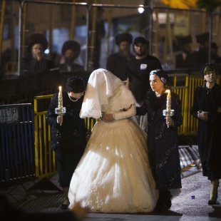 Ultra-Orthodox Jewish women walk with Penet, the bride of Rokeach, grandson of the Chief Rabbi of Belz, during a wedding ceremony in Jerusalem