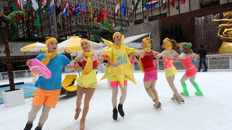 IMAGE DISTRIBUTED FOR GREATER FORT LAUDERDALE - Swimsuit clad ice skaters take to The Rink at Rockefeller Center as Greater Fort Lauderdale Convention & Visitors Bureau (CVB) transforms it into a tropical island paradise for the launch of CVB's new Hello Sunny campaign, Wednesday, Jan. 16, 2013, in New York.  CVB's new promotion encourages New Yorkers and the nation to enjoy the warm Greater Fort Lauderdale sunshine. (Photo by Diane Bondareff/Invision for Greater Fort Lauderdale/AP Images)