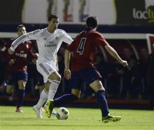 Osasuna's Flano fights for the ball with Real Madrid's Ronaldo during their Spanish King's Cup match in Pamplona