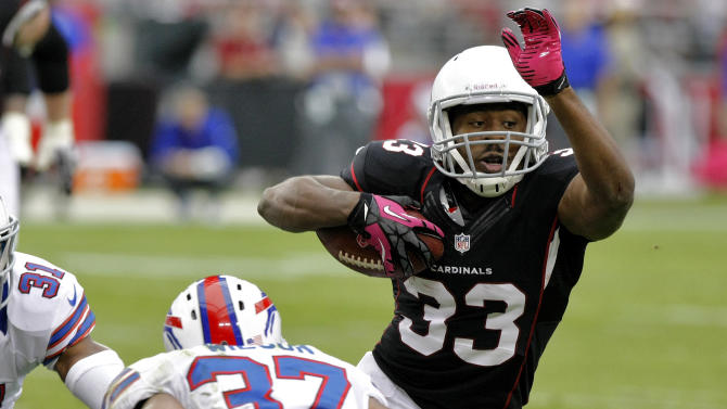 Arizona Cardinals running back William Powell (33) gains yardage as Buffalo Bills strong safety George Wilson (37) defends during the first half of an NFL football game on Sunday, Oct. 14, 2012, in Glendale, Ariz. (AP Photo/Rick Scuteri)