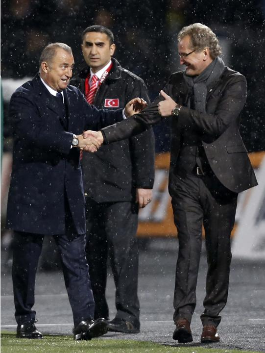 Sweden's coach Erik Hamren shakes hands with Turkey's coach Fatih Terim after their international friendly soccer match at 19 Mayis Stadium in Ankara