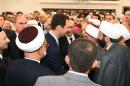 In this photo released by the Syrian official news agency SANA, Syrian President Bashar Assad, center, shakes hands with worshippers on the first day of Eid al-Fitr marking the end of the Muslim fasting month of Ramadan at the Khair mosque, in Damascus, Syria, Monday, July 28, 2014. (AP Photo/SANA)