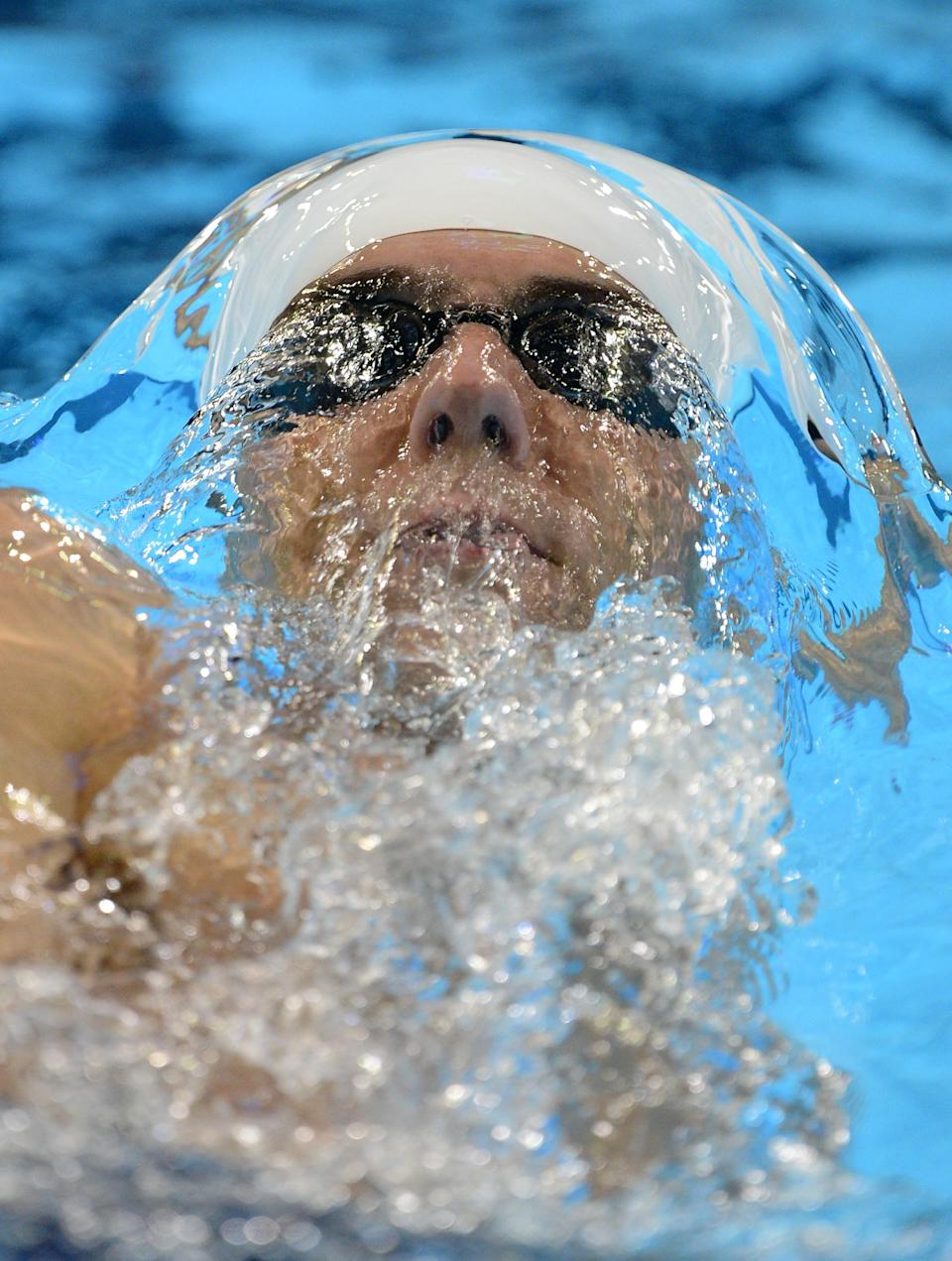 Michael Phelps swims in the men's 400-meter individual medley preliminaries at the U.S. Olympic swimming trials, Monday, June 25, 2012, in Omaha, Neb. (AP Photo/Mark J. Terrill)