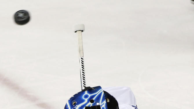 Tampa Bay Lightning goalie Ben Bishop blocks a shot by the New York Rangers during the first period of Game 7 of the Eastern Conference final during the NHL hockey Stanley Cup playoffs, Friday, May 29, 2015, in New York. (AP Photo/Kathy Willens)