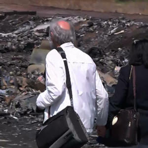 Family of MH17 Victim Pay Respects at Crash Site