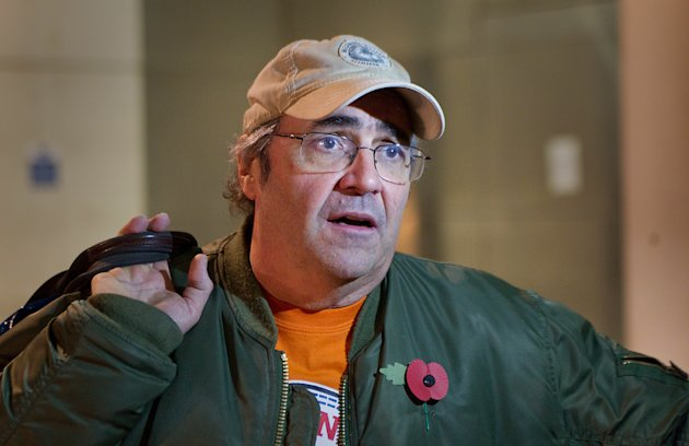 In this photo taken Thursday, Nov. 1, 2012, British DJ Danny Baker speaks to the media outside the British Broadcasting Corporation&#39;s (BBC) Broadcasting House after announcing that his show on BBC London radio had been canceled, London. Baker opened his afternoon slot on BBC London radio Thursday by announcing that the show had been canceled. The BBC confirmed Baker was due to leave at the end of the year, but could not say whether he would complete his contract. (AP Photo/PA, Philip Toscano) UNITED KINGDOM OUT, NO SALES, NO ARCHIVE