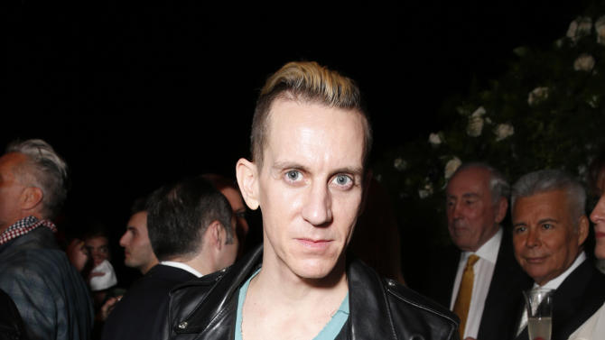 IMAGE DISTRIBUTED FOR PORTON - Jeremy Scott salutes legend of art and fashion Mario Testino with cocktails by Porton at the Peruvian native's exhibition at Prism on Saturday February 23, 2013 in Los Angeles. (Photo by Todd Williamson/Invision for Porton/AP)