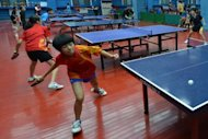 Children are seen during a table tennis training session at the Shichahai Sports School in Beijing. China's status as a sporting superpower was achieved on the back of intense state-led training in schools, but the current crop of coaches and students say there is life outside the sports halls