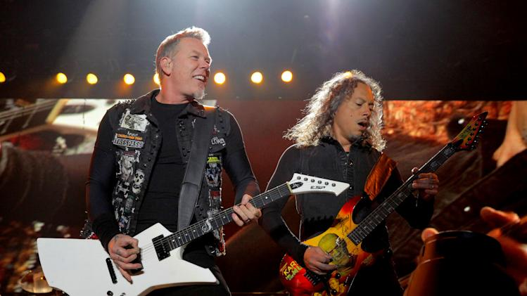 FILE - This Oct. 27, 2012 file photo shows James Hetfield, left, and Kirk Hammett of Metallica performing at the Voodoo Music Experience in New Orleans. All music spanning Metallica's 30-year history is now available on Spotify. The company announced the move Thursday, Dec. 6, during a presentation to debut new features in New York. Metallica had previously refused to stream its music.  (Photo by Barry Brecheisen/Invision/AP, file)
