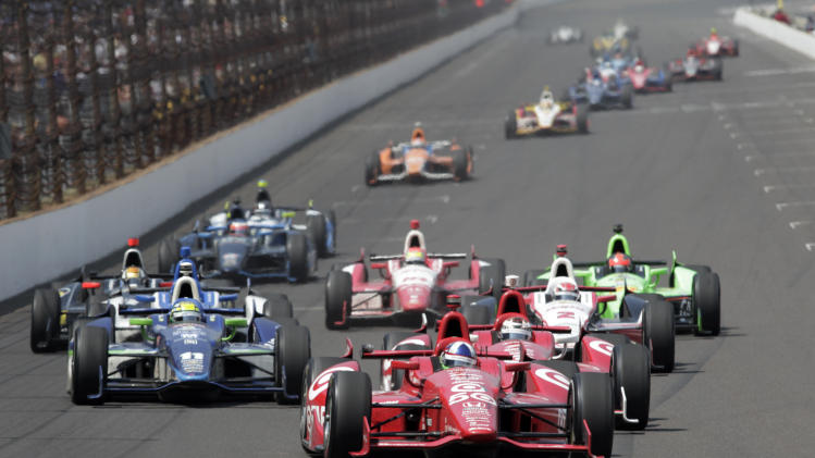Dario Franchitti, of Scotland, leads the field on the restart of Lap 194 during IndyCar's Indianapolis 500 auto race at Indianapolis Motor Speedway in Indianapolis, Sunday, May 27, 2012. Franchitti went on to win the race. (AP Photo/AJ Mast)