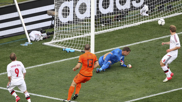 Denmark's Michael Krohn-Dehli, left, scores the opening goal during the Euro 2012 soccer championship Group B match between the Netherlands and Denmark in Kharkiv , Ukraine, Saturday, June 9, 2012. (AP Photo/Michael Probst)