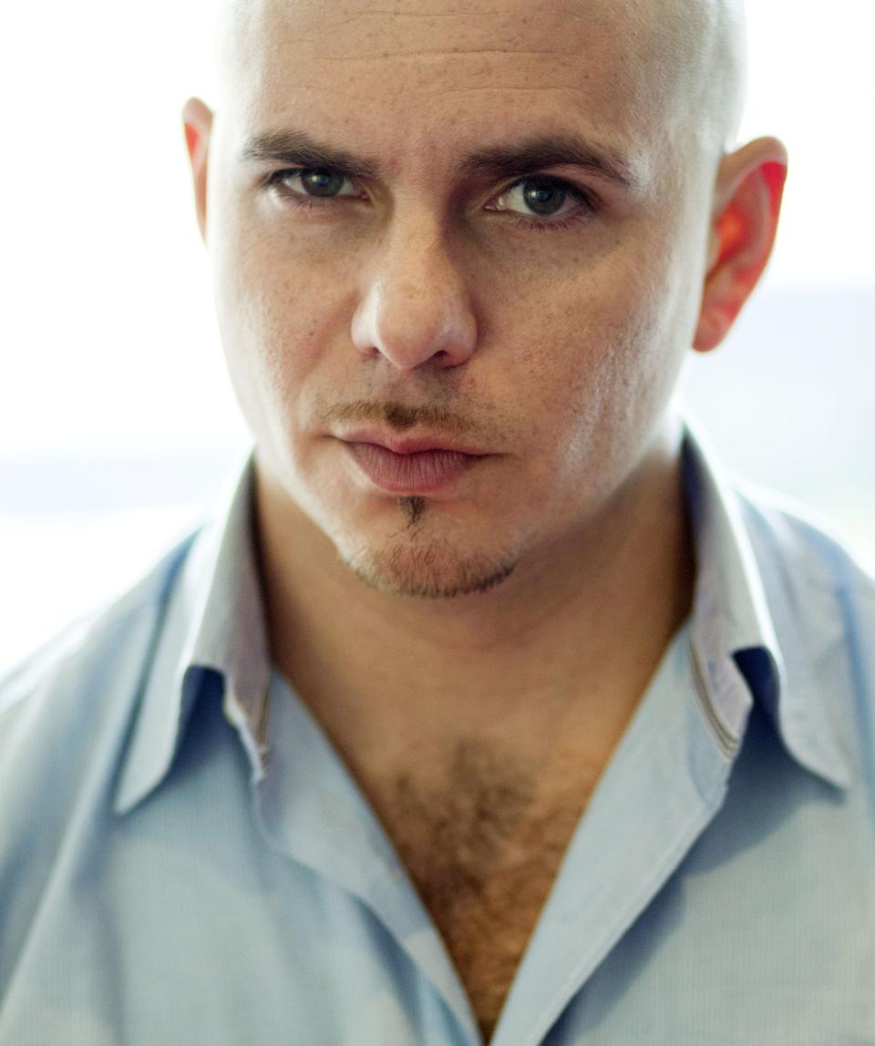 FILE - In this June 21, 2011 file photo, rapper Pitbull poses for a portrait in Los Angeles. Pitbull is one of many artists who have churned out platinum-plus hits, but has not matched that success when it comes to album sales. (AP Photo/Matt Sayles, file)