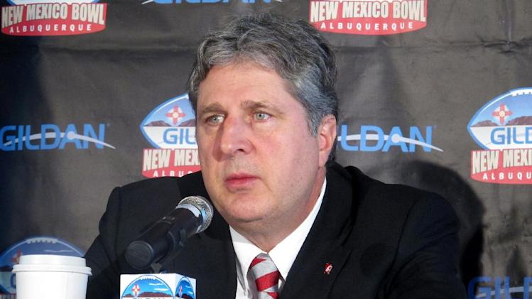 Washington State coach Mike Leach speaks to members of the media at the Isleta Resort & Casino in Isleta Pueblo, N.M., Friday, Dec. 20, 2013.  Colorado State (7-6) will meet Washington State (6-6) in the New Mexico Bowl on Saturday in Albuquerque, N.M