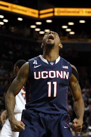 No. 18 UConn holds off Maryland 78-77
