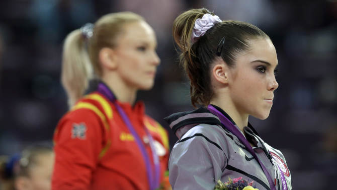 U.S. gymnast McKayla Maroney, right, stand along with Romania's gymnast Sandra Raluca Izbasa during the podium ceremony for the artistic gymnastics women's vault finals at the 2012 Summer Olympics, Sunday, Aug. 5, 2012, in London.  (AP Photo/Julie Jacobson)