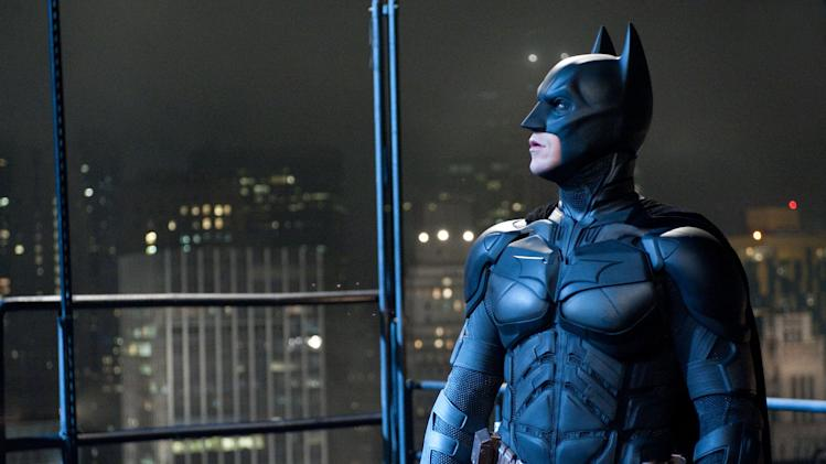 "This image released by Warner Bros. shows Christian Bale as Batman in ""The Dark Knight Rises."" Some comic book historians are concerned that the chaotic mass shooting at a midnight screening of ""The Dark Knight Rises"" in suburban Denver will forever be associated with the legend of Batman. They are keen on disregarding any parallels between the massacre and the ever-evolving history of Batman, a flawed human superhero who has been rooted in reality since his pulpy inception in 1939. (AP Photo/Warner Bros., Ron Phillips)"