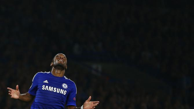 Chelsea's Drogba reacts during their Champions League soccer match against Schalke 04 at Stamford Bridge in London