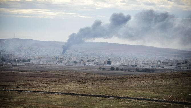 Smokes rises from the Syrian town of Kobane, also known as Ain al-Arab, as it is seen from the Turkish village of Mursitpinar, on October 19, 2014