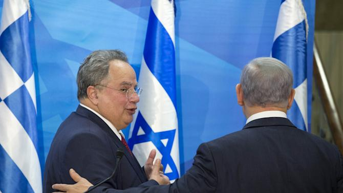 Greek Foreign Minister Nikos Kotzias and Israel's Prime Minister Benjamin Netanyahu stand together during a joint news conference in Jerusalem