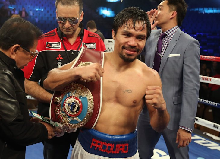 Manny Pacquiao will defend the WBO welterweight title against one-time kickboxer Chris Algieri on Nov. 22 in Macau, China.  (AFP Photo/Jeff Gross...