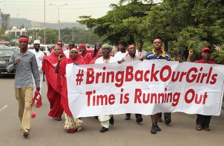 """Campaigners from """"#Bring Back Our Girls"""" march during a rally calling for the release of the Abuja school girls who were abducted by Boko Haram militants, in Abuja"""