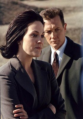 "Agent Monica Reyes (Annabeth Gish, L) and Agent John Doggett (Robert Patrick, R) investigate Mulder?s disappearance in the ""This Is Not Happening"" episode of Fox's The X-Files X-Files"