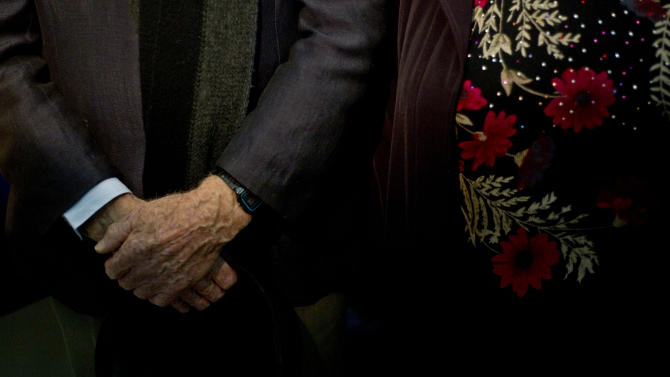 "Holocaust survivor 83-year-old Shlomo Resnik and his wife attend the memorial's ""Gathering the Fragments"" exhibit at Yad Vashem of more than 71,000 items collected nationwide over the past two years in Israel's national Holocaust memorial and museum in Jerusalem, Sunday, Jan. 27, 2013. His item was the steel bowl that he and his father used for food at the Dachau concentration camp. His father Meir's name and number are engraved on the bowl, which serves as a reminder of how hard they had to scrap for food. ""We fought to stay alive,"" he said. (AP Photo/Ariel Schalit"