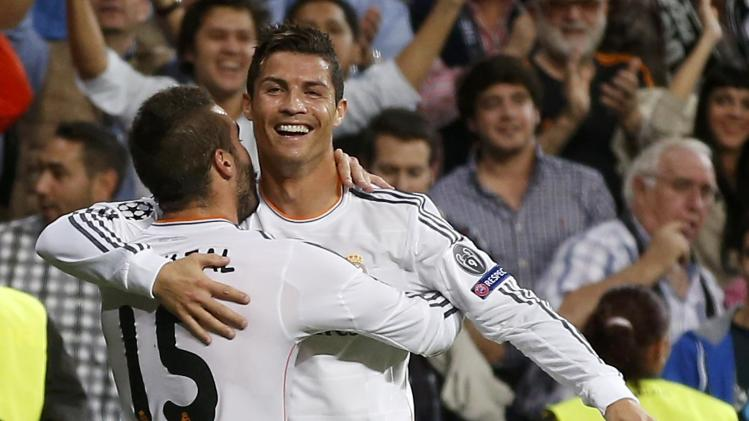 Real Madrid's Ronaldo celebrates his goal against FC Copenhagen with team-mate Carvajal during their Champions League soccer match in Madrid