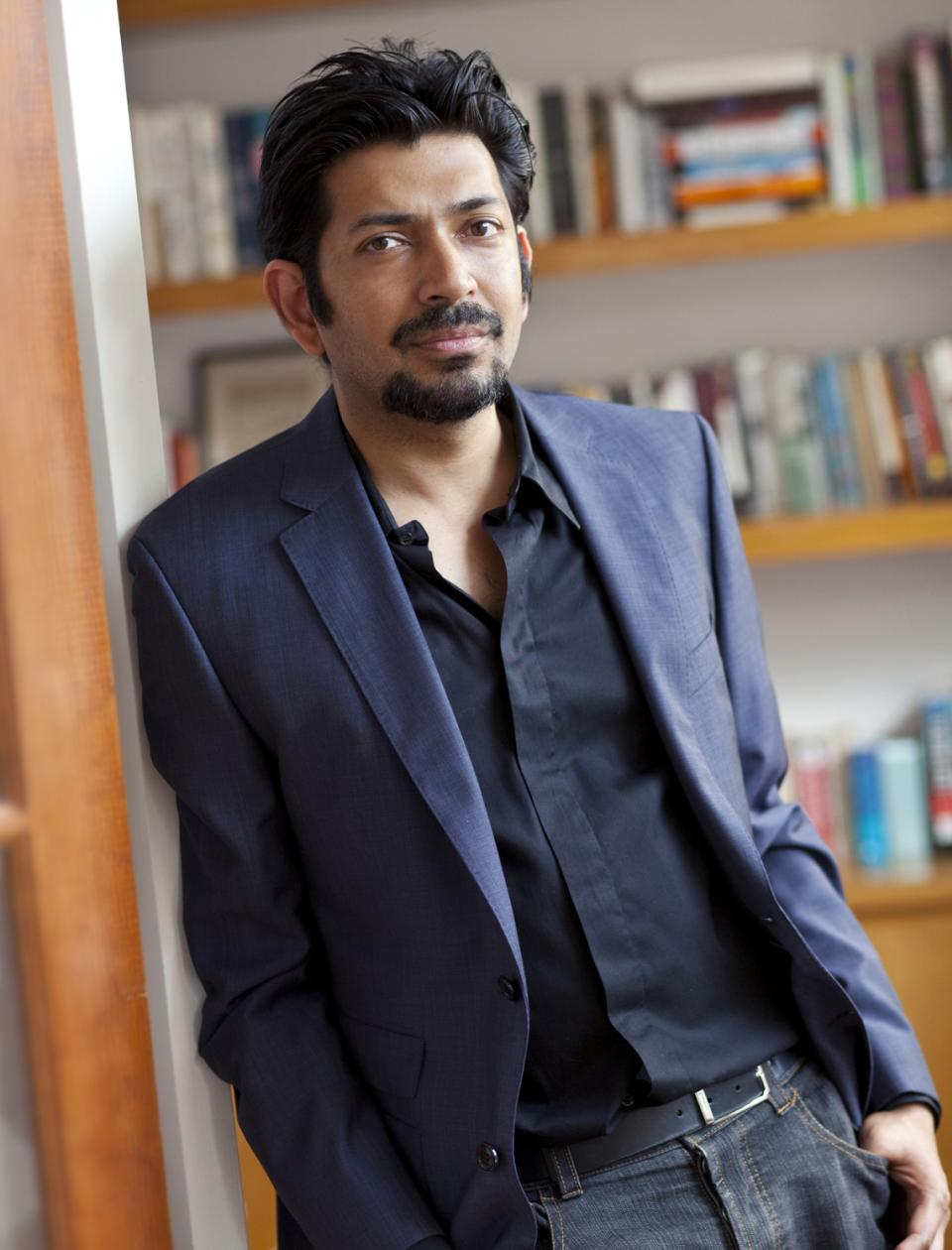 In this undated  publicity image provided by Simon & Schuster, Siddhartha Mukherjee, author of The Emperor of All Maladies: A Biography of Cancer, is shown. Mukherjee and documentary filmmaker Ken Burns are collaborating on a film based on the book. (AP Photo/Simon & Schuster, Deborah Feingold)