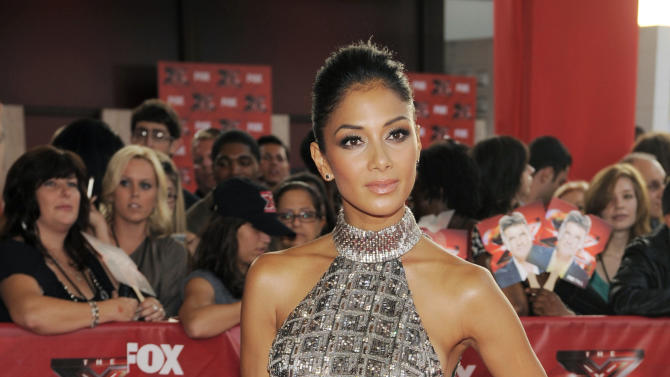 "Nicole Scherzinger, a judge on ""The X Factor,"" poses at a world premiere screening event for the new television series, Wednesday, Sept. 14, 2011, in Los Angeles. The competition series gives viewers the opportunity to choose the next breakout music star or group. (AP Photo/Chris Pizzello)"