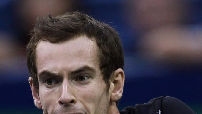 Andy Murray of Britain returns a shot to David Ferrer of Spain during their singles final of the Shanghai Masters tennis tournament in Shanghai, China, Sunday, Oct. 16, 2011. (AP Photo/Alexander F. Yuan)