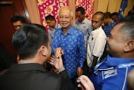 Malaysia's Prime Minister Najib Razak (C) is greeted by his supporters after winning the elections at his party headquarters in Kuala Lumpur early May 6, 2013. REUTERS/Bazuki Muhammad