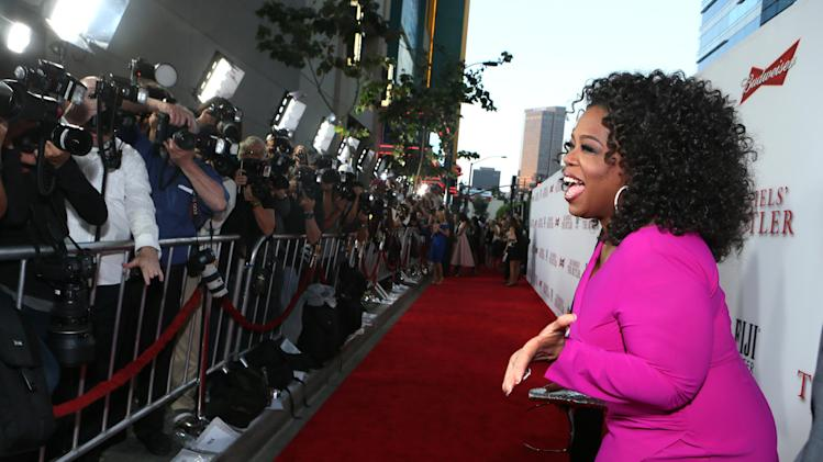 "Oprah Winfrey appears at the Los Angeles Premiere of ""The Butler,"" Monday, Aug. 12, 2013, in Los Angeles. (Photo by Alexandra Wyman/Invision/AP Images)"