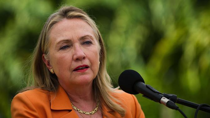 U.S. Secretary of State Hillary Rodham Clinton speaks during a joint press conference with New Zealand Prime Minister John Key at the New Zealand high commissioner's house in Rarotonga, Cook Islands, Friday, Aug. 31, 2012. (AP Photo/Jim Watson, Pool)