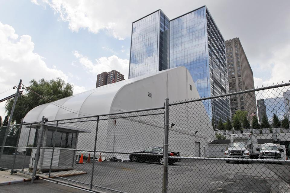 This Wednesday, Aug. 10 2011 photo shows a tent which houses a chapel and a storage of the remains of victims of the attacks on the World Trade Center near Chief Medical Examiner Office Forensic Biology Lab in New York.  (AP Photo/Mary Altaffer)
