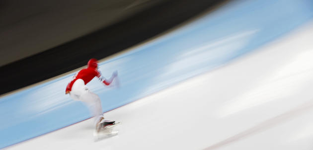 In this picture taken with a long exposure, Danil Sinitsyn of Russia competes during the men's 5000m race at the speed skating World Cup in Inzell, southern Germany, Friday, March 7, 2014