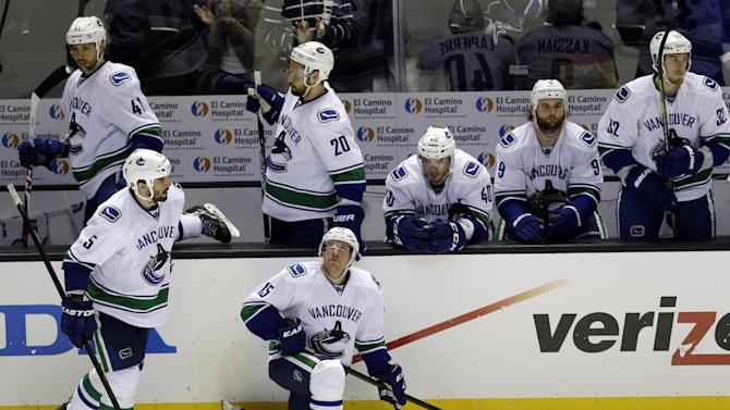 The Vancouver Canucks prepare to leave the ice after a loss to the San Jose Sharks during overtime of Game 4 of their first-round NHL hockey Stanley Cup playoff series in San Jose, Calif., Tuesday, May 7, 2013. San Jose won 4-3 in overtime. (AP Photo/Marcio Jose Sanchez)