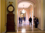 The Ohio Clock shown outside the Senate Chamber on Capitol Hill on Thursday, Oct. 10, 2013 in Washington. The Ohio Clock has stood watch over the Senate for 196 years. It stopped running shortly after noon Wednesday. Employees in the Office of the Senate Curator ordinarily wind the clock weekly. But they are among the thousands of federal employees furloughed under the partial shutdown. (AP Photo/ Evan Vucci)