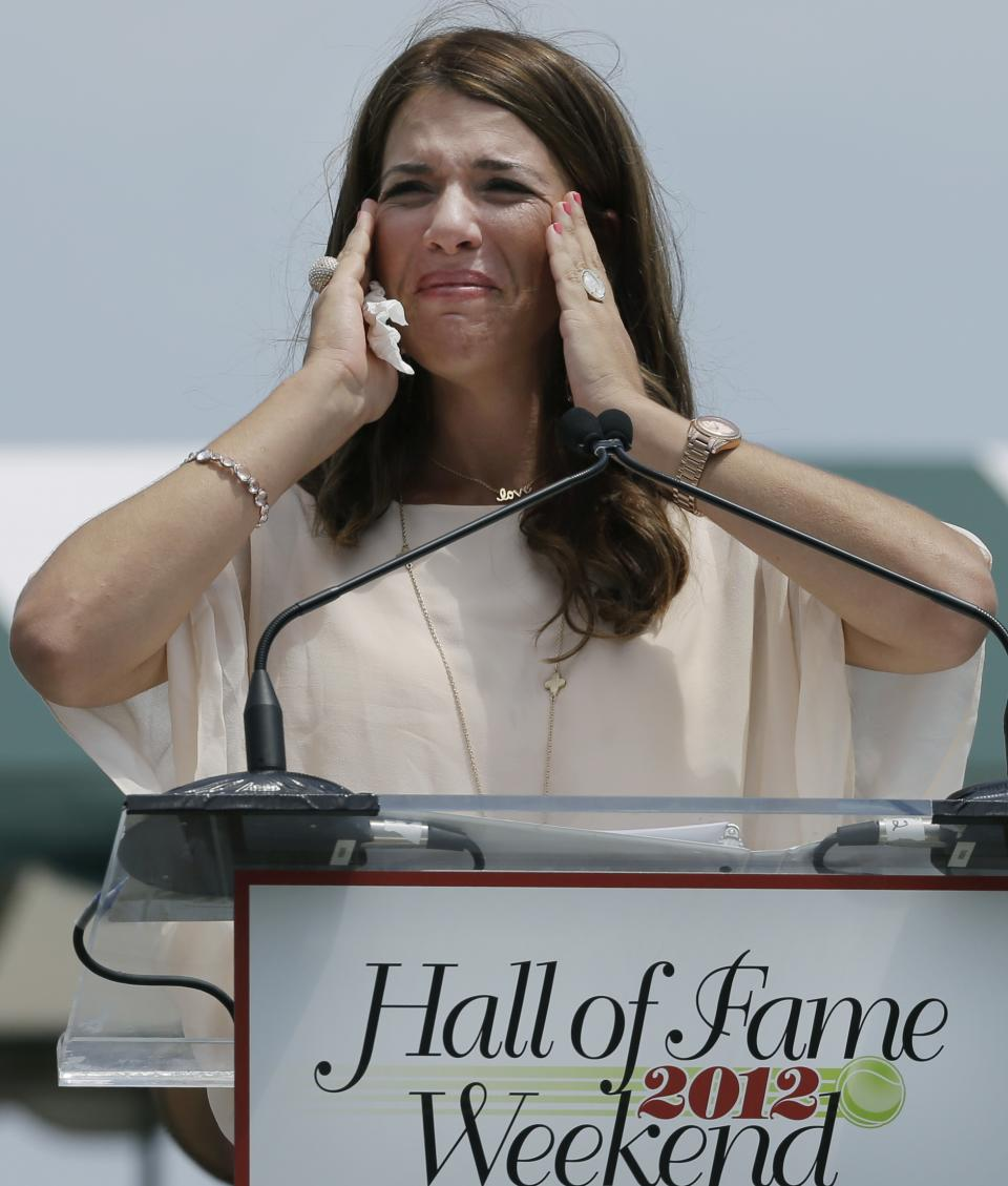 International Tennis Hall of Fame inductee Jennifer Capriati of Tampa, Fla. becomes emotional as she speaks during induction ceremonies in Newport, R.I. Saturday, July 14, 2012. (AP Photo/Elise Amendola)