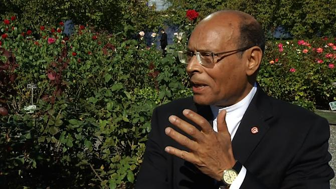 In this video image taken from AP video, Tunisian President Moncef Marzouki, talks with a reporter at United Nations headquarters Monday, Sept. 23, 2013. Marzouki is in New York for the United Nations General Assembly. He plans on meeting with new Iranian President Hassan Rouhani during his visit. (AP Photo/AP video)