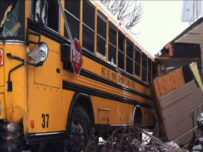 Raw: Iowa School Bus Crashes Into House