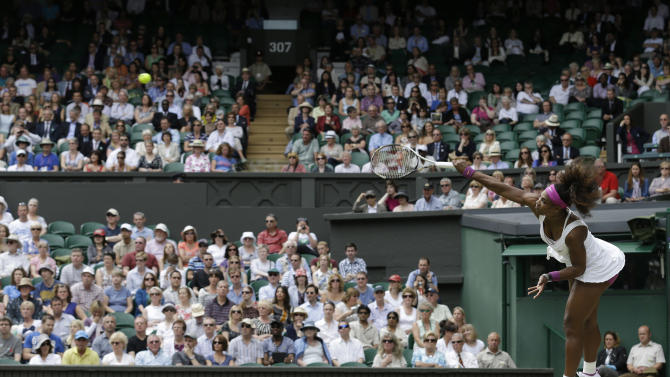 Serena Williams of the United States serves to Victoria Azarenka of Belarus during a semifinals match at the All England Lawn Tennis Championships at Wimbledon, England, Thursday, July 5, 2012. (AP Photo/Anja Niedringhaus)