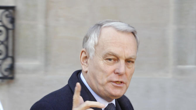 French Prime Minister Jean Marc Ayrault gestures toward reporters as he leaves the Elysee Palace following a Defense meeting with French President Francois Hollande, in Paris, Wednesday Jan 16, 2013.(AP Photo/Remy de la Mauviniere)
