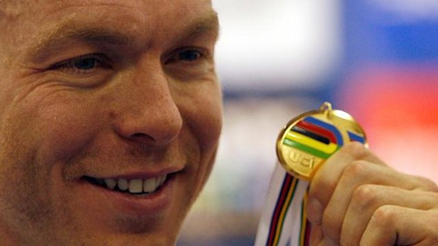 Britain's Chris Hoy poses with his gold medal after the Men's Keirin during the UCI 2010 World Track Cycling Championships in Copenhage
